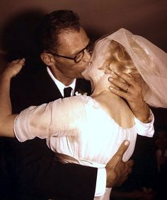 Marilyn Monroe and Arthur Miller on their wedding day. Photo by Milton Greene, 1956.