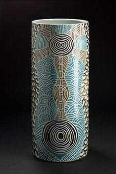 Cylindrical pot with blue and brown circular patterns on the exterior.