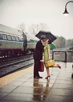 Last Kiss.love the foot kick.vintage kiss goodbye at the train. Kissing In The Rain, Walking In The Rain, Rain Umbrella, Under My Umbrella, I Love Rain, Parasols, Train Tracks, Grafik Design, Rain Drops