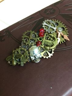 Cogs and gears Steampunk Brooch in Bronze with Skull, Bee, Anchor, Clock hands and a touch of red. Ideal Unisex Gift. One off unique design by InspiredbySteamPunk on Etsy