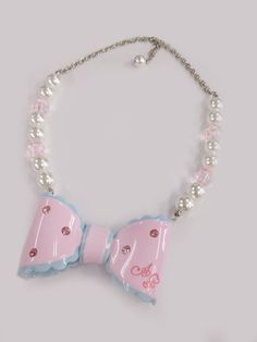 Angelic Pretty: Dream ribbon necklace in pink and sax