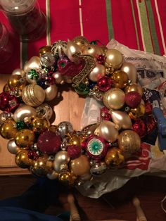 Ornament wreath made for a friend. Old ornaments hot-glued to foam wreath form that was wrapped in burlap for better adhesion. Enjoy!