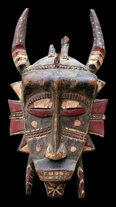 Africa | Kpelie mask from the Senufo people of Ivory Coast | Wood and paint