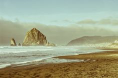 This Haystack Rock photo, taken outside Cannon Beach on the Oregon Coast, features a beautiful Northwest beach on a surprisingly clear January day. The rock itself is the site of the Goonies cave scen