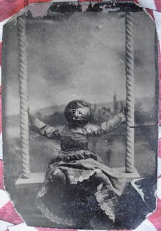 Tintype photo of a doll on a swing