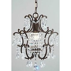 @Overstock - Clear Crystal Brown Base Chandelier - Illuminate your home with this elegant crystal chandelier. This classic light fixture pays tribute to the Victorian era with its draped clear crystals over a brown finish. To bring life to these high-quality crystals only one bulb is required.    http://www.overstock.com/Home-Garden/Clear-Crystal-Brown-Base-Chandelier/4512400/product.html?CID=214117  $80.99