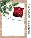 White painted wooden panel with fir branch and pictures for year's end - stock photo