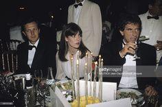 Opening Dinner. Le 42ème Festival de CANNES se déroule du 11 au 23 mai : la princesse CAROLINE DE MONACO attablée entre son mari Stefano CASIRAGHI et Jack LANG un verre à la main.