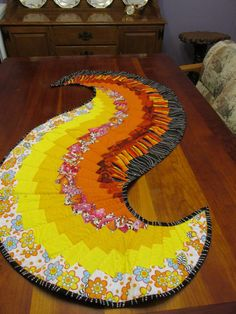 Spicy Spiral Table Runner with an Festive Theme by 3ChicksSewing