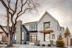 This elegant farmhouse home features two-toned siding, lots of windows, and boasts a modern yet classic style. Read on and get inspiration! Rustic Home Design, Farmhouse Design, Rustic Farmhouse, Farmhouse Ideas, Modern Farmhouse Exterior, Modern Farmhouse Style, Farmhouse Interior, Interior Modern, Modern Contemporary Homes