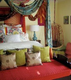 I LOVE the colors in this bedroom, not to mention the hangings and the chair in the corner!