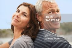 Royalty-free Image: Middle aged couple back to back smiles