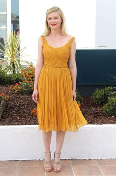 Kirsten Dunst. Too much gold and her features don't pop as much.