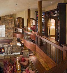 Love the bookshelves, rock, wood, beams ...
