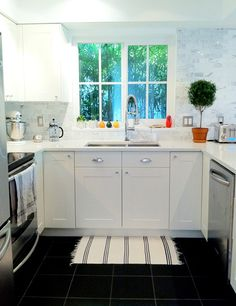 Kitchen from New Domestic. They engraved little messages on the marble tile backsplash. I want, I want, I want....