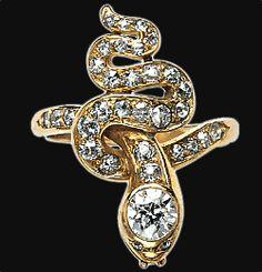 Diamond snake ring containing one diamond .50 carat and thirty-two diamond