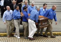 Pallbearers wearing blue shirts with rolled up sleeves, carry the coffin of the television pitchman, Billy Mays, from the church where the funeral mass was held in Mays' hometown, in the Pittsburgh suburb of McKees Rocks, Pa., Friday, July 3, 2009. (AP Photo/Keith Srakocic)