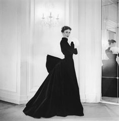 Model in evening gown reminiscent of the Belle Epoque by Jacques Griffe, photo by Willy Maywald, 1951.