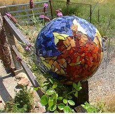This was made by my personal friend, Martina Thurlow. Sunburst bowling ball made with stained glass.