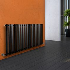 Milano Aruba - Luxury Anthracite Horizontal Designer Double Radiator x - Grey Anthracite Horizontal Designer Radiator in orange hallway Solid Brick, Brick And Wood, Wooden Flooring, Concrete Floors, Horizontal Designer Radiators, Roof Insulation, Double Vitrage, Support Mural, Types Of Rooms