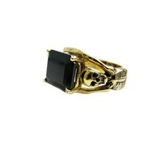 Two brass skeletons clutch a jet black emerald cut Onyx. Unless your size is…