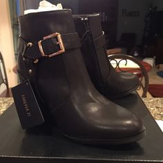 """New in Box Forever 21 Buckled Booties. price firm New in Box Forever 21 Buckled Booties. Black with gold buckles. Size 6. Never worn. Missed the return period.  Sold out online and in stores.  Model is 5' 0.5"""" so the shaft comes up a bit high on her calf. price firm. Forever 21 Shoes Heeled Boots"""