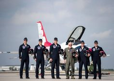 Retired Air Force colonel and astronaut Buzz Aldrin poses with the USAF Thunderbirds during a visit April 2 in Melbourne, Fla. Thunderbirds photo