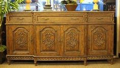 Beautiful carved sideboard buffet with 4 doors, 3 drawers, interior adjustable shelf.  Buffet is constructed of oak with a dark walnut finish. #OnTheShowroomFloor #Beautiful #Carved #Sideboard #Buffet #Walnut #DarkWalnut #DiningRoom #Dining #LivingRoom #Kitchen #Office #Study #Foyer #Entry #StillGoode