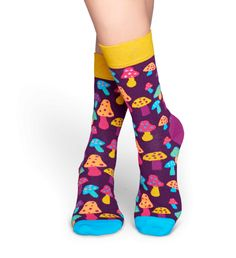 Nothing says fun like a pair of colorful shroom socks. These purple socks feature a band of yellow at the top, a light purple heel and blue toes. Plus, multicolored mushrooms speckle the landscape to liven up these illustrative socks with flamboyant color. Fine-combed cotton was used to ensure high-quality comfort and maximum style for women and men to enjoy.