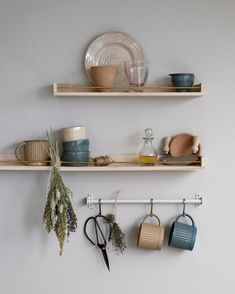 The shelves delicately display dinnerware made for warm and cosy times. - Find more of the collection in the catalogue through the link in the bio. Boho Kitchen, Kitchen Decor, Kitchen Interior, Ikea Spice Rack, Diy Kitchen Shelves, Kitchen Utilities, Concrete Kitchen, House Rooms, Display Shelves