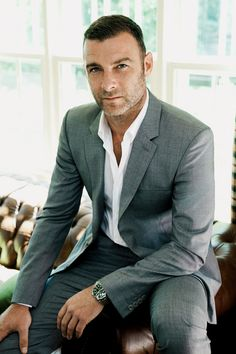 Liev Schreiber, looking great in a tailored grey suit with a classic white shirt. #mensfashion #lievschreiber