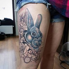 Rabbit tattoo with flowers on leg