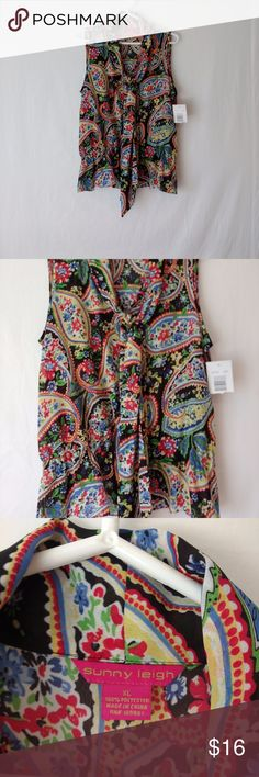 """Sunny Leigh Blouse Flowing Multi-Color Paisley XL Sunny Leigh Size XL Bow Blouse Flowing Paisley Multi Color Shirt. Tag attached never worn. Photos are part of the description & feel free to ask questions.  Sleeveless pullover top with bow at neck and loosely gathered at waist. Multi-color black, blue, yellow, green, & red paisley floral print. Pretty, semi-sheer flowing Polyester fabric. Measured flat approximately... Armpit to armpit: 21 1/2"""" Length from shoulder to bottom: 25"""" Ships…"""