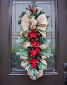| Burlap Christma Swag. with poinsettias, fresh and fresh greens
