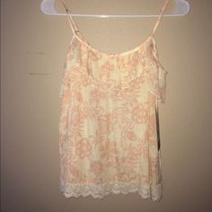 SOLD‼️‼️Tank top Cream and light pink tank top with while lace. Bought at Nordstrom. Never worn with tags. Sun and shadow Tops Tank Tops