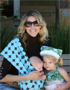 I wore my reversible chocolate and blue Peanut Shell sling with 2-year-old Arthur on my back right up until my pregnant belly got too big. A mom can use these from birth until the kid is about three years old...they are as great for concerts and festies as they are for attachment/babywearing at home.