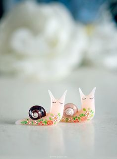 More tattooed snails, this time in translucent pink. Find them in my clay shop. | by {JooJoo}