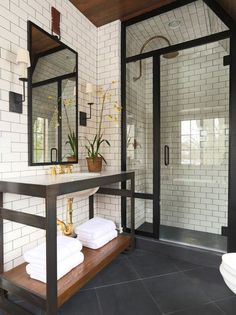 Masculine #bathroom with steel finishes, subtle brass accents, and gorgeous walk-in shower
