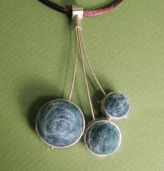 love the combo of felted wool and sterling silver