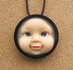 This is the creepiest upcycle thing I've ever seen.  Too weird not to pin! (but NEVER EVER do)--Upcycle doll parts necklace
