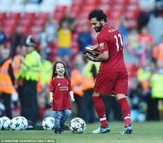 Salah celebrated on the Anfield pitch after winning another personal accolade with his goal against Brighton sealing the Premier League Golden Boot and helping Liverpool to secure a top-four finish. Mohamed Salah Liverpool, Baseball Card Values, Lifetime Basketball Hoop, Mo Salah, Liverpool Fans, Baseball Pants, Baseball Live, Basketball Leagues, Soccer Training