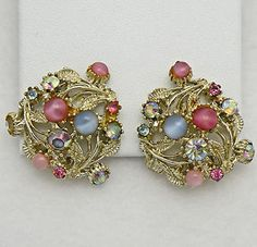 Lovely Goldtone Plated Clip On Earrings featuring Beautiful Pastel Pink and Blue Faux Moonstones with Pink Blue and Aurora Borealis Rhinestone accents.