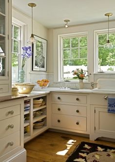 Kitchen corner...love the open shelves and the great use of space and light, plus the rustic floors are perfect