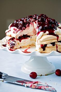 Perfect pavlova | fluffy meringues layered with billowy whipped cream and marscapone cheese, topped off with fresh cherry and red wine compote