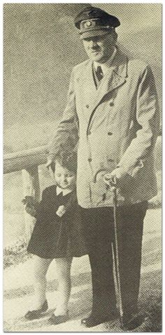Adolf Hitler and a child at the Mooslahnerkopf Overlook.