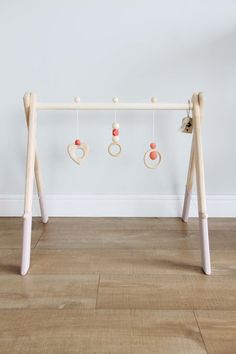 ♥♥♥♥A beautiful handmade wooden baby gym that is perfect for your babys first months of exploring the world. Most of the frame and toys are untreated with paints and any oils so its very pleasant to touch.  All the hanging toys are handmade from natural beech wood, the frame is made of birch wood. Bottom of the frame is painted with chalk paint.♥♥♥♥  Dimensions: L57cm W53cm H53cm