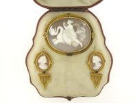 Antique demi-parure of shell cameo brooch and earrings by John Brogden.  England  Circa 1870