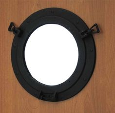Round Iron Porthole Mirror ~ Nautical Wall Decor by UD, http://www.amazon.com/dp/B001VT1JB8/ref=cm_sw_r_pi_dp_7IjCrb03M8HKR