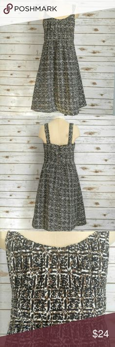 New York & Company Black tan and brown Dress New York & Company Black tan and brown patterned dress . Size 4 100% cotton. Mid length, perfect for a warm summer day. Check out the rest of my closet for cardigan cover ups! New York & Company Dresses Midi