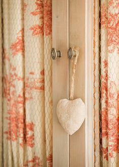 curtains and heart.  peach and cream